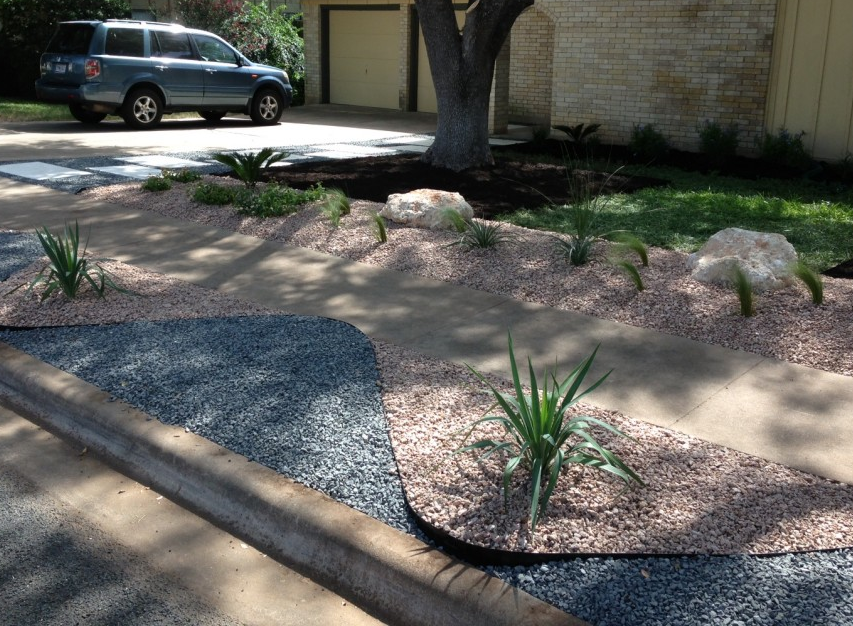 Portfolio river rock landscaping for Landscaping rocks austin